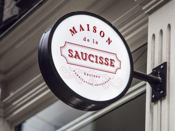 <span>Maison de la Saucisse</span><i>→</i>